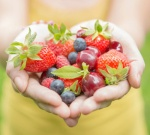 anti-aging-foods-woman-holding-fruits-179013608